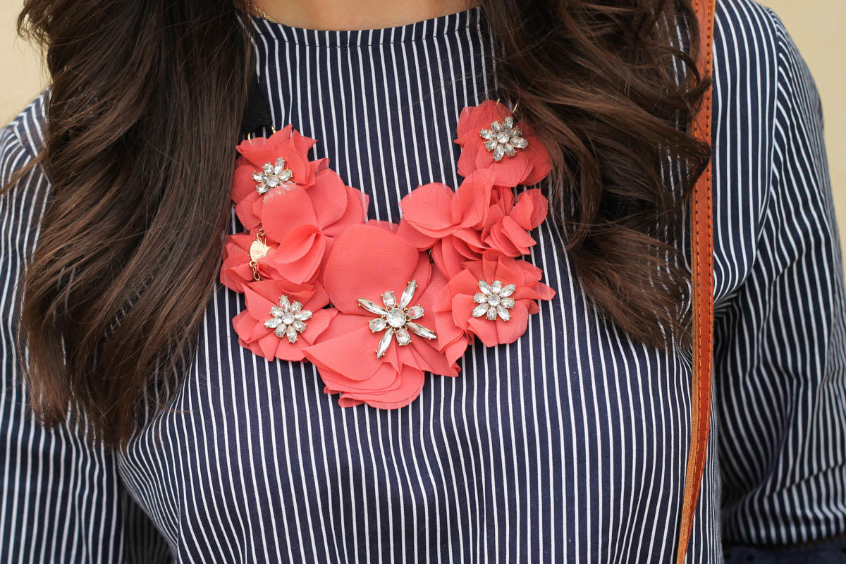 A Navy Eyelet Blouse and Floral Necklace
